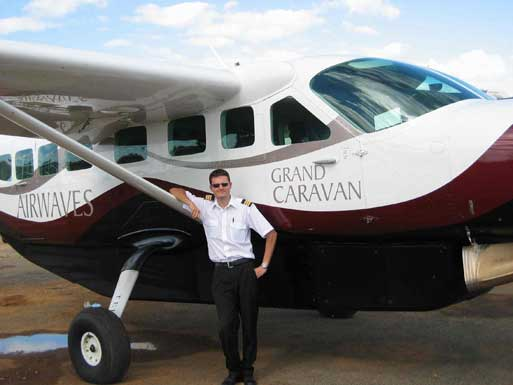 Michael Channer in front of Grand Caravan airplane